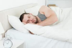 a man sleeping comfortably on his side