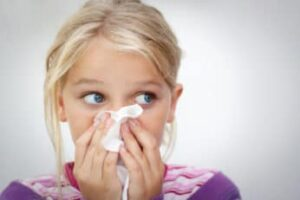 a sneezing young girl