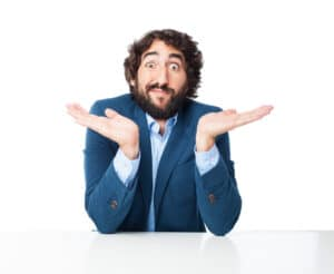 confused businessman with sit table