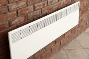 a-convector-mounted-on-a-brick-wall