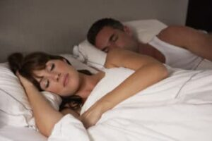 a-couple-asleep-in-bed