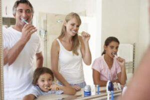 a-family-brushing-their-teeth-together