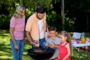 a-family-having-a-meal-outdoors
