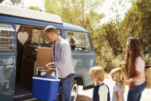 a-family-using-a-cool-box-for-camping