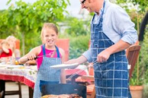 a-girl-helping-her-dad-with-the-griller