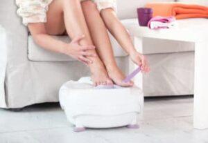 a woman having a foot bath and pedicure