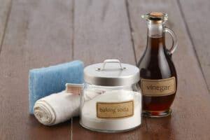 baking soda, cloth, and vinegar
