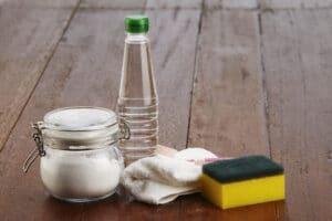 baking soda, vinegar, and scrubbing pad