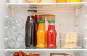 bottles with juice stored in fridge
