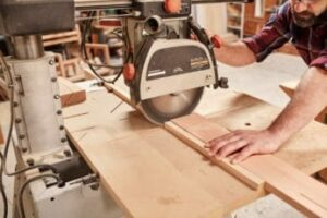 carpenter-cutting-a-piece-of-wood