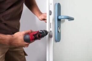 carpenter-installing-a-door-lock