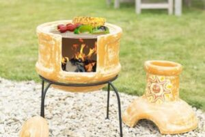 cooking-food-in-a-clay-chiminea