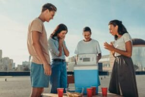 friends-using-a-12-volt-cool-box-during-a-party
