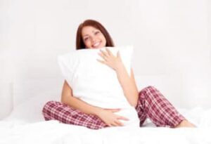girl-hugging-a-cushion