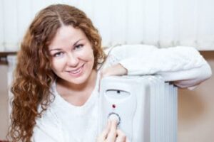 happy-woman-adjusting-the-temperature