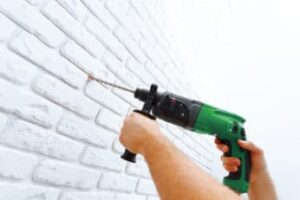 man-drilling-a-concrete-wall