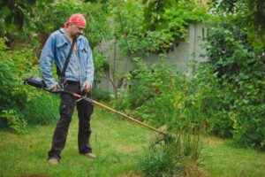 man-using-a-cordless-strimmer