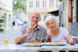 old-couple-eating-fried-food