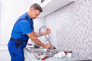 plumber working on the kitchen sink