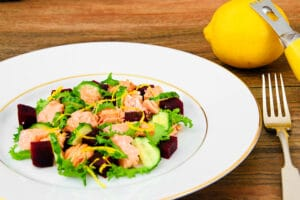 salad with salmon, greens, and citrus zest