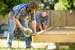 two-men-busy-with-their-outdoor-project