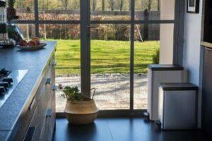 two-waste-bins-standing-in-a-kitchen-corner