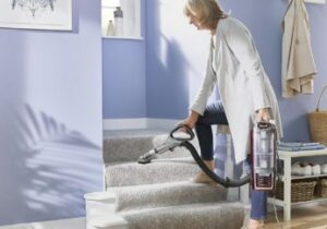 vacuuming-stairs-with-a-handheld