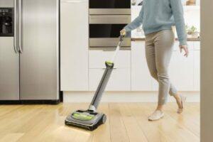 vacuuming-the-kitchen-floor