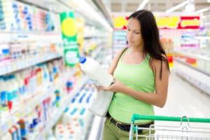 woman buying milk in store