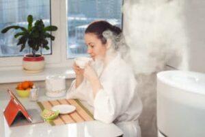 woman-drinking-tea-beside-humidifier