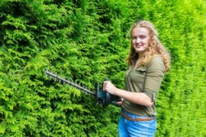 woman-using-a-lightweight-hedge-trimmer