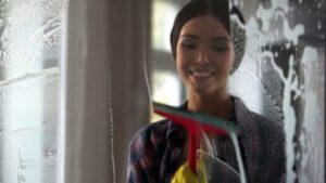 woman-washing-a-glass-surface