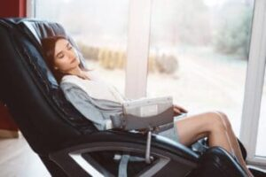 young-woman-relaxing-on-a-massage-recliner