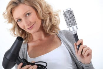 a woman holding a hair dryer