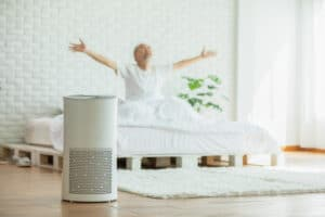 air filtration device and elderly person in white bedroom