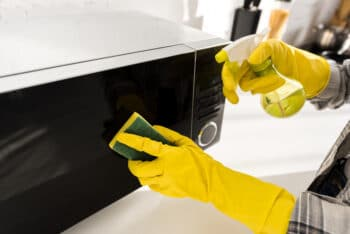 cleaning a kitchen appliance