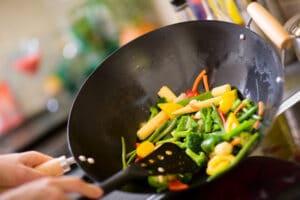 cooking veggies in a wok