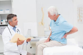 doctor discussing with eledrly patient