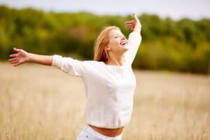 gleeful lady with outstretched arms