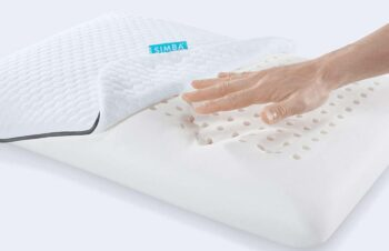hand pushing on cushion made from a viscoelastic material