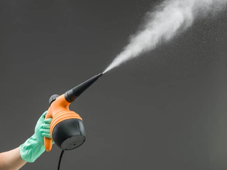 how to use a handheld steam cleaner
