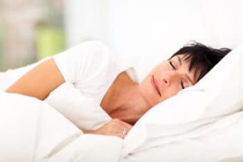 mature woman sleeping on side