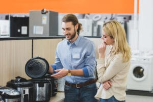 sales clerk and customer in appliance store