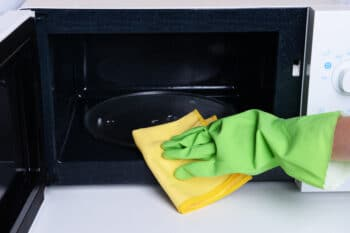scrubbing an oven's turntable