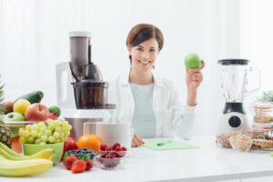 woman with a juicer and a blender