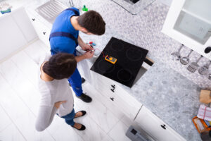 workman installing a modern cooker