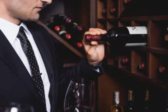a-gentleman-pulling-out-a-bottle