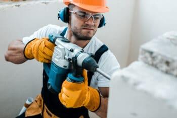 a man drilling a wall