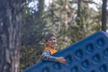 a-girl-in-the-woods-carries-an-air-mattress