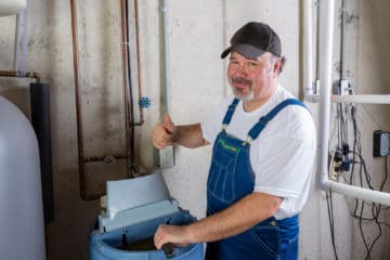 man installing a water softener